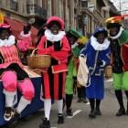 Originele en huidige versie van Sinterklaas en Zwarte Piet